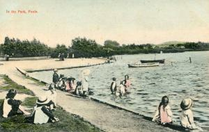 Children Playing In Boating Lake